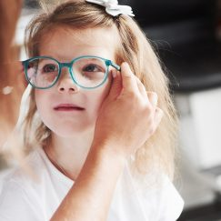 Young girl being fitted for glasses