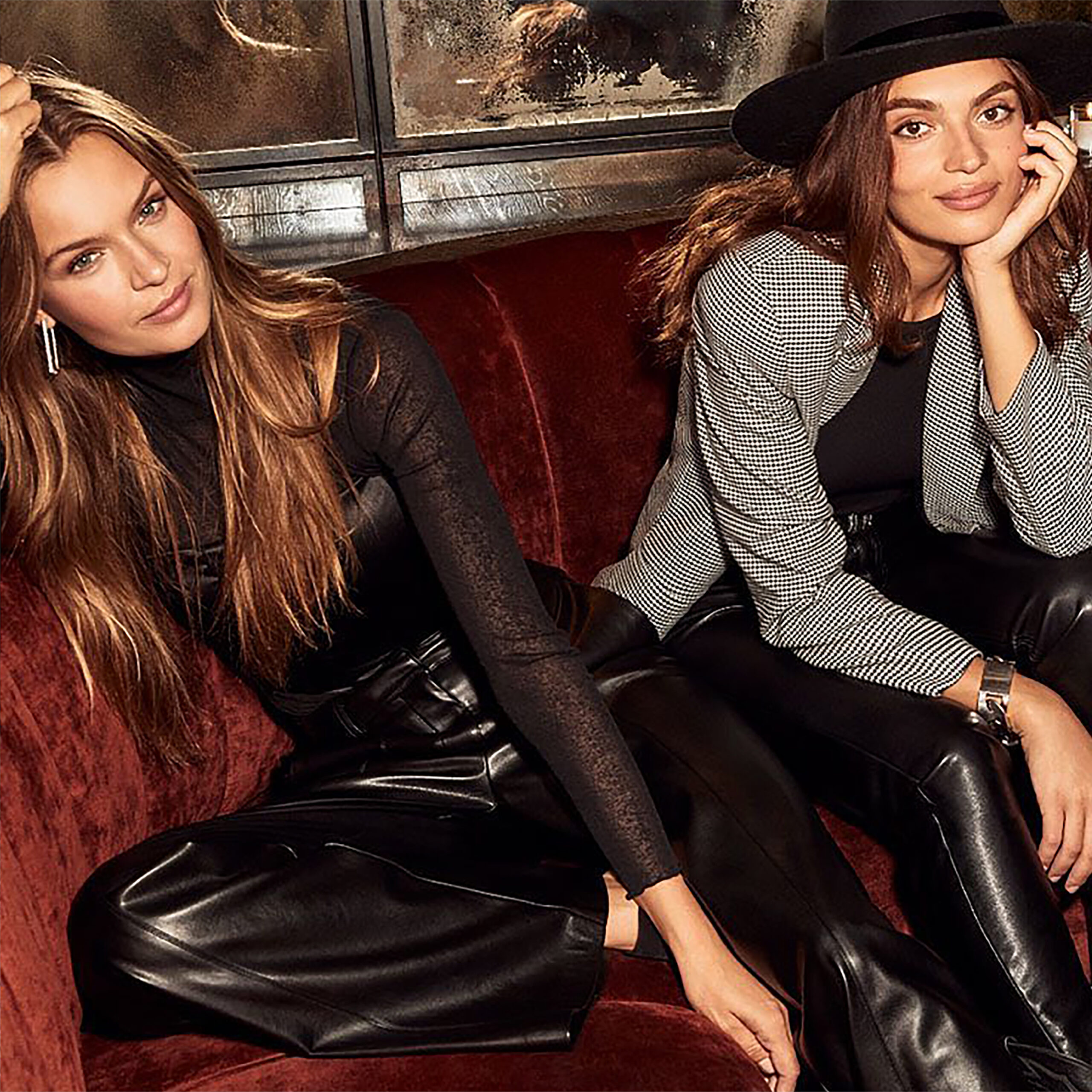 2 chic girls sitting on couch
